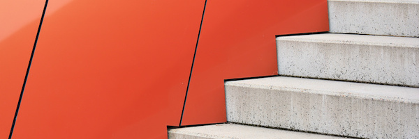 Stairs against an orange background
