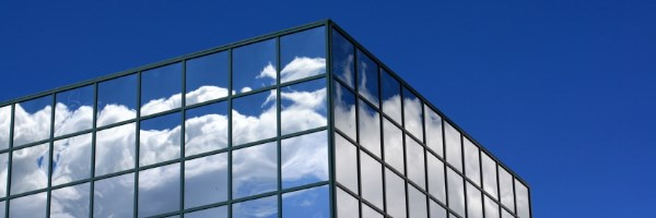 Glass building with blue sky